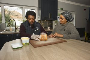 photo - Habiba working with one of the residents at Ashford House